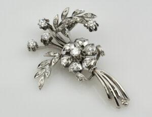 Brosche 585/000 14 K Weißgold 24 Diamanten zus. 1,00 ct