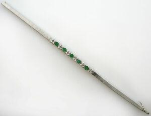 Armband 18,5 cm 750/000 18 K Weißgold / 5 Smaragde / 24 Diamanten zus. 0,50 ct